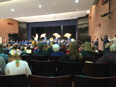 the marching band playing in the high school auditorium