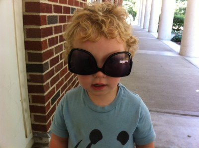 Harvey wearing Mama's sunglasses upsidedown