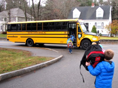 kids getting on the school bus
