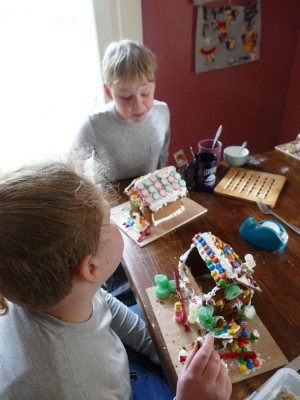 Harvey and Zion disassembling gingerbread houses