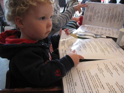 Harvey looking at a menu