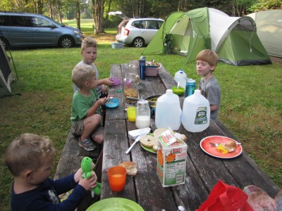 kids eating breakfast at the campsite