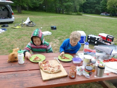 Harvey and Zion at a picnic table eating pizza