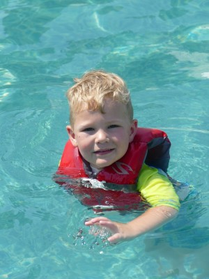 Lijah swimming in a pool