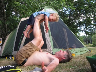 me airplaning Lijah in front of the tent