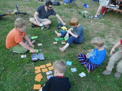 Tim and the boys playing Pokemon on the grass