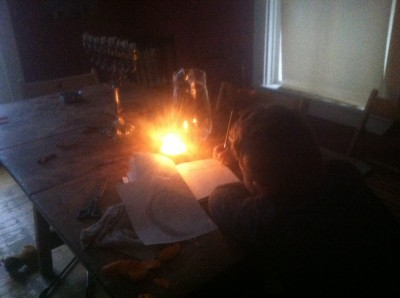 Harvey doing homework by candlelight