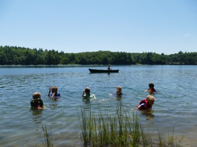 the boys and friends swimming in Walden pond, with the canoe