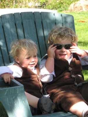 Zion and Harvey relaxing in a shared Adirondack chair