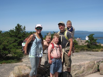 the Archibalds posing at the signpost atop Champlain Mtn