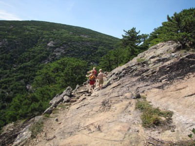 the boys walking along a sloping ridge on the west side of Champlain