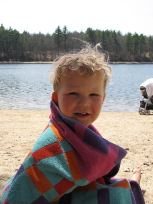 Lijah smiling with this towel over him