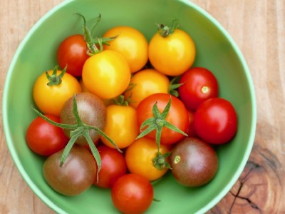 different varieties of cherry tomatoes in a bowl