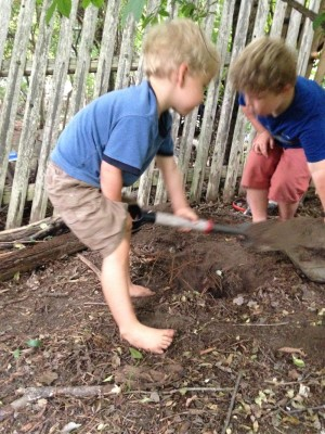 Zion and Harvey digging a hole