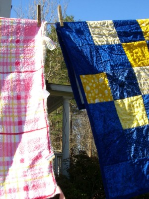 christmas quilts drying on the line