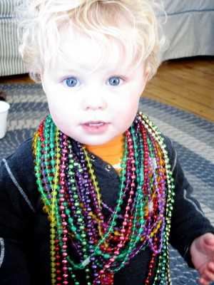 Harvey loaded up with Mardi Gras beads from a church fair