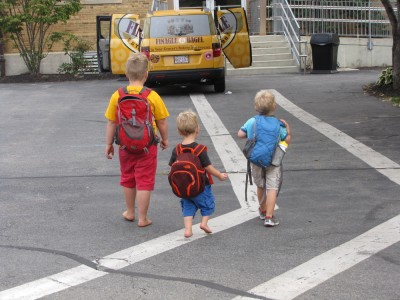 the three boys, in backpacks, headed into church