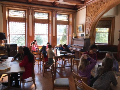 homeschoolers playing board games in an elegant room at the Lincoln Public Library