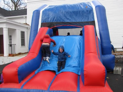 Harvey and Zion on the slide of a giant bounce house