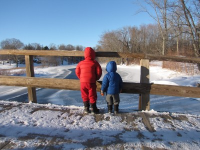 Harvey and Zion on the Old North Bridge looking down on the frozen river