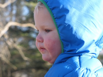 Lijah's face in profile, bundled in the hood of his down coat