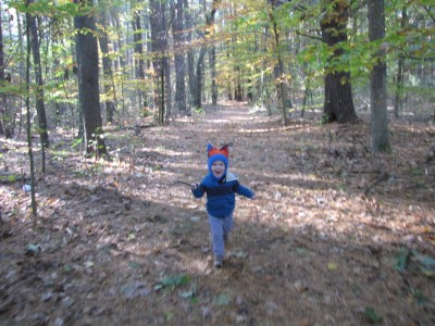 Lijah running in the woods