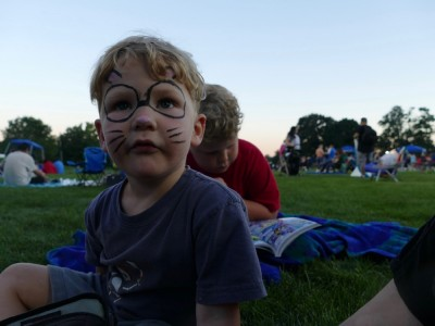 Lijah in face paint at an outdoor concert