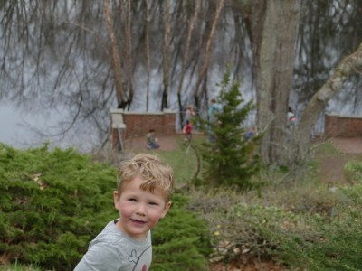 Lijah up high above the Concord River; other kids on a pavilion nearer the water