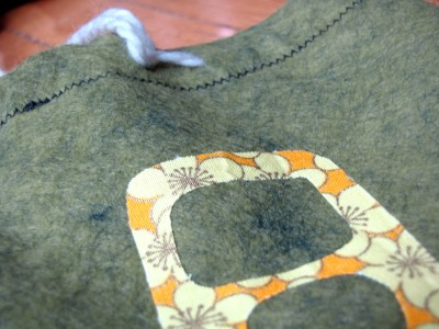 detail of the applique on a cord bag