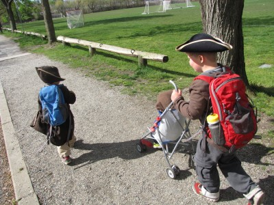 the boys walking along a path, in pirate (and monkey) costumes