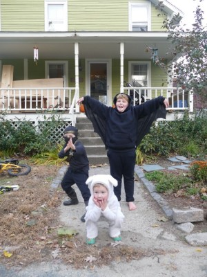 sheep Lijah, ninja Zion and bat Harvey posing in front of the house