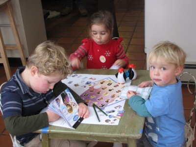 Harvey, Zion, and their cousin Leighanna working on an art project