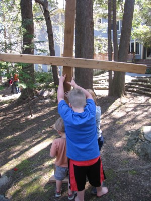 Harvey, Zion, and Nathan putting up a wooden cross