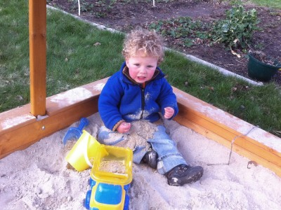 Harvey in the sandbox covered with sand
