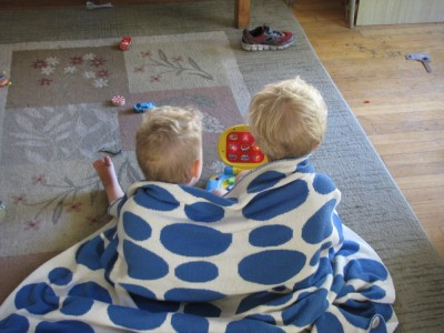 Zion and Lijah sharing a blanket