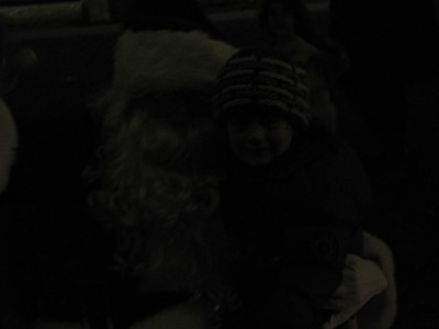 Julen sitting on Santa's lap... in the very dark
