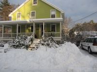 the front of the house with snow
