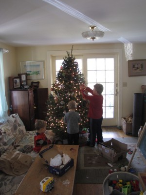the boys decorating the tree