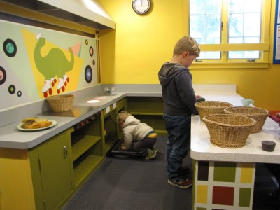 Lijah and Harvey working in the life-sized play kitchen