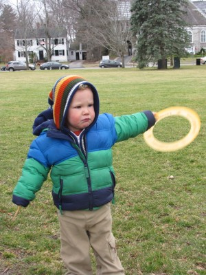 Lijah on Lexington Green lookin serious with a frisbee