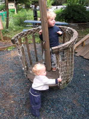 boys playing on the discovery playground