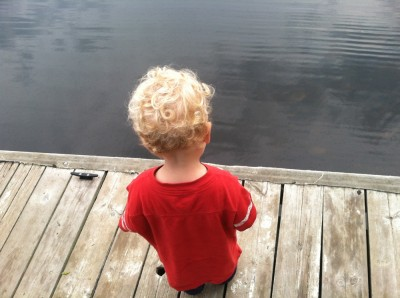 Lijah standing on a dock looking at the water