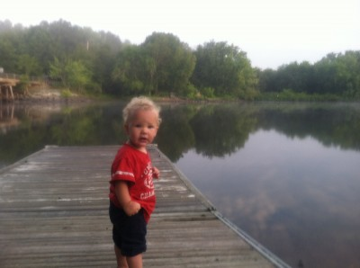 Lijah standing on the dock at the boat launch