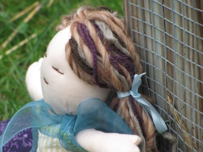 a close-up of the doll's yarn hair