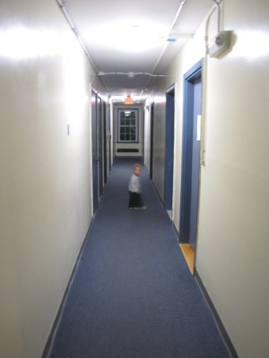 Lijah exploring the hallway in the dorm