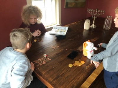 the boys playing dreidel on the kitchen table