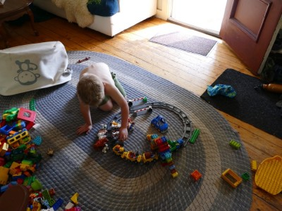Zion playing with duplo train tracks