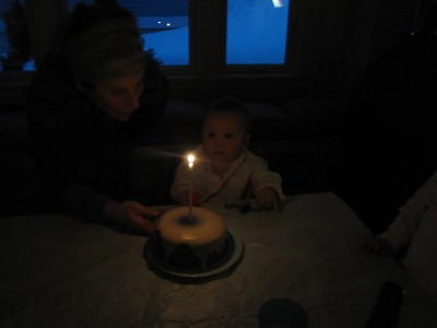 Elijah in the dark looking at his lit birthday candle