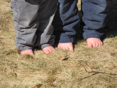 Zion's and Harvey's bare feet in the yellow winter grass