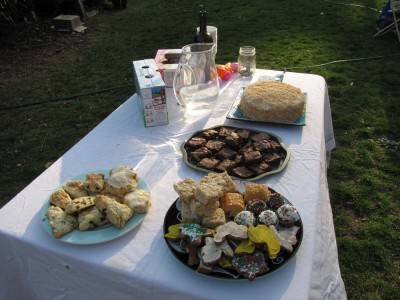 lots of desserts on the table outside
